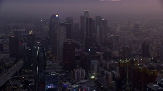 AX0156_065 - 8K stock footage aerial video of The Ritz-Carlton and Downtown Los Angeles, California as the sun rises