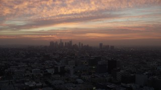 AX0156_071 - 8K stock footage aerial video of golden clouds above Downtown Los Angeles, California early in the morning