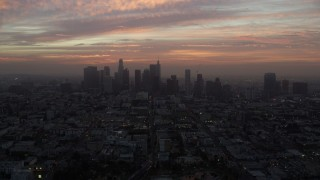 AX0156_072 - 8K stock footage aerial video of golden clouds above Downtown Los Angeles skyline, California early in the morning