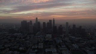 AX0156_073 - 8K stock footage aerial video approaching the Downtown Los Angeles skyline, California early in the morning