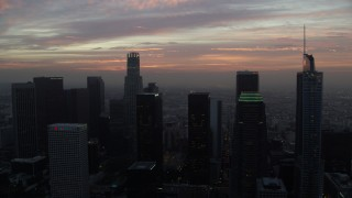 AX0156_074 - 8K stock footage aerial video approaching US Bank Tower and high-rise buildings in Downtown Los Angeles, California early in the morning