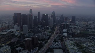 AX0156_078 - 8K stock footage aerial video of skyscrapers and heavy morning commute traffic on 110 freeway in Downtown Los Angeles, California