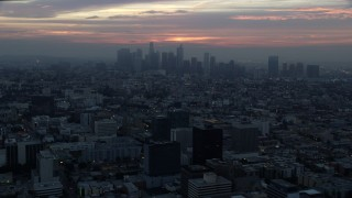AX0156_082 - 8K stock footage aerial video approaching the Downtown Los Angeles, California skyline on a hazy morning