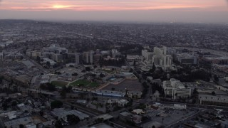 AX0156_090 - 8K stock footage aerial video of the University of Southern California Health Sciences Campus in Boyle Heights, Los Angeles, California at sunrise