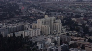 AX0156_092 - 8K stock footage aerial video orbiting General Hospital at USC Health Sciences Campus in Boyle Heights, Los Angeles, California at sunrise