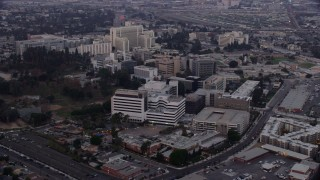 AX0156_098 - 8K stock footage aerial video of Keck Hospital and General Hospital of University of Southern California in Boyle Heights, Los Angeles, California at sunrise