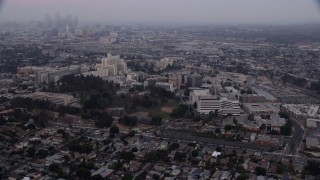 AX0156_099 - 8K stock footage aerial video flying by University of Southern California Health Sciences Campus in Boyle Heights, Los Angeles, California at sunrise