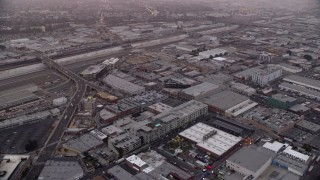 AX0156_103 - 8K stock footage aerial video of warehouse and apartment buildings in the Arts District of Downtown Los Angeles, California at sunrise