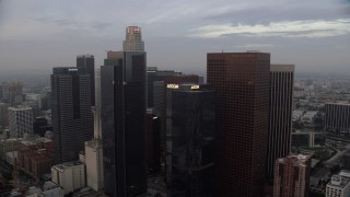AX0156_105 - 8K stock footage aerial video of US Bank Tower and skyscrapers in Downtown Los Angeles, California at sunrise