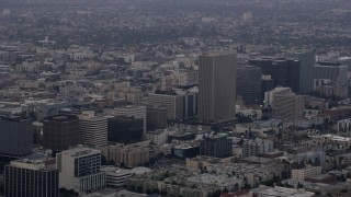 AX0156_107 - 8K stock footage aerial video of office buildings and the Equitable Life Building in Koreatown, Los Angeles, California at sunrise