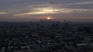 AX0156_109 - 8K stock footage aerial video approaching Koreatown office buildings and the skyline of Downtown Los Angeles, California at sunrise