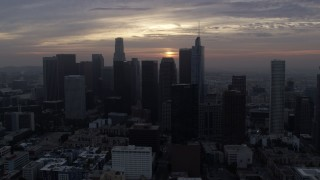 AX0156_112 - 8K stock footage aerial video approaching the tall towers of Downtown Los Angeles, California at sunrise