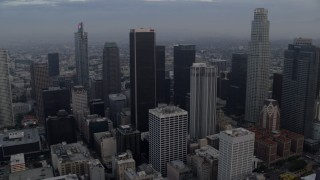 AX0156_115 - 8K stock footage aerial video flying through Downtown Los Angeles, California at sunrise, and reveal Westlake