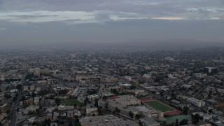 AX0156_116 - 8K stock footage aerial video flying over homes and Belmont High School in Westlake, Los Angeles, California at sunrise