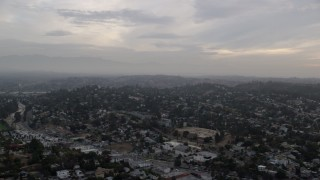 AX0156_117 - 8K stock footage aerial video flying by residential neighborhoods in Echo Park and Silver Lake at sunrise, Los Angeles, California