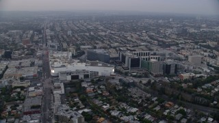 AX0156_122 - 8K stock footage aerial video orbit of Beverly Center and Cedars-Sinai Medical Center at sunrise, Beverly Hills, California