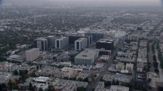 AX0156_125 - 8K stock footage aerial video orbiting Cedars-Sinai Medical Center at sunrise in Beverly Hills, California