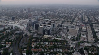 AX0156_127 - 8K stock footage aerial video orbiting Beverly center and Cedars-Sinai Hospital, sunrise, Beverly Hills, California