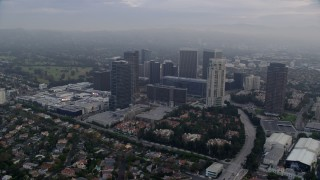 AX0156_134 - 8K stock footage aerial video orbiting away from shopping mall and skyscrapers, sunrise, Century City, California