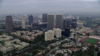 AX0156_136 - 8K stock footage aerial video of condominiums and skyscrapers near Beverly Hills High School, sunrise, Century City, California