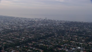 AX0156_143 - 8K stock footage aerial video flying over residential neighborhoods, sunrise, Santa Monica, West Side, California