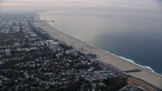 AX0156_145 - 8K stock footage aerial video flying over residential toward beach and Pacific Ocean, Santa Monica Pier, Santa Monica, California