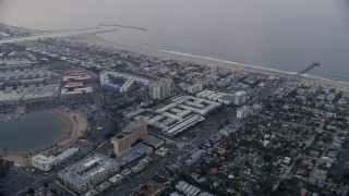 AX0156_153 - 8K stock footage aerial video flying over Venice toward Marina Del Rey condominium complexes at sunrise, California
