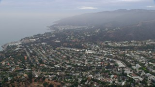 AX0156_161 - 8K stock footage aerial video flying over Palisades Charter High School and coastal neighborhoods at sunrise, Pacific Palisades, California