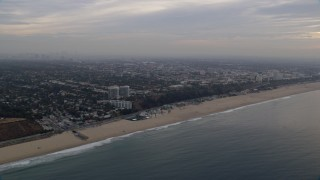 AX0156_167 - 8K stock footage aerial video of light traffic on Pacific Coast Highway on the edge of Pacific Palisades / Santa Monica at sunrise, California
