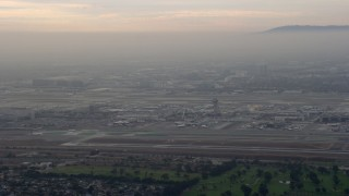 AX0156_179 - 8K stock footage aerial video of LAX in a thick cloud covering, sunrise, Los Angeles, California