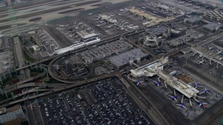 AX0156_181 - 8K stock footage aerial video flying over LAX and parked airplanes, sunrise, Los Angeles, California