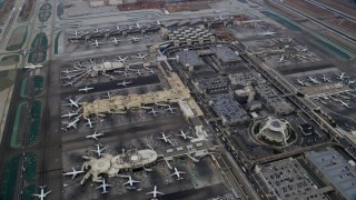AX0156_182 - 8K stock footage aerial video flying over LAX, sunrise, Los Angeles, California