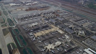 AX0156_183 - 8K stock footage aerial video of a reverse fly over of LAX, sunrise, Los Angeles, California