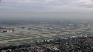 AX0156_188 - 8K stock footage aerial video of LAX at sunrise on a cloudy day, Los Angeles, California