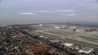 AX0156_194 - 8K stock footage aerial video tracking a jet as it lifts off from LAX, California in the morning