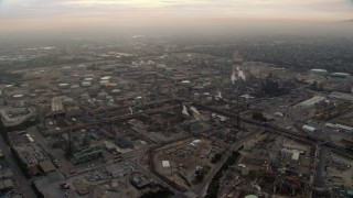AX0156_196 - 8K stock footage aerial video flying by an oil refinery in El Segundo, California, sunrise
