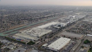 AX0156_200 - 8K stock footage aerial video flying by Hawthorne Airport in the morning in Hawthorne, California