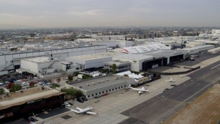 AX0156_204 - 8K stock footage aerial video of SpaceX HQ and Tesla Design Center at Hawthorne Airport, California