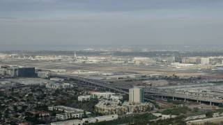 AX0157_002 - 8K stock footage aerial video flying by Interstate 105 and 405 Interchange toward LAX, Los Angeles, California