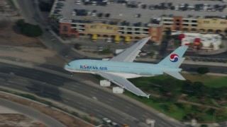 AX0157_007 - 8K stock footage aerial video of Korean Air A380 landing at LAX, Los Angeles, California