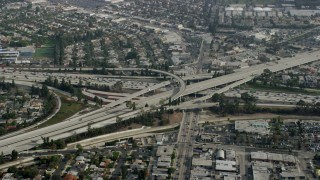 AX0157_009 - 8K stock footage aerial video flying away from the 405 / Hwy 2 Interchange, Westchester, California