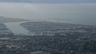 AX0157_011 - 8K stock footage aerial video of coastal community and harbors, hazy, Marina Del Rey, California
