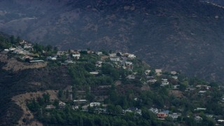 AX0157_015 - 8K stock footage aerial video of hillside homes in the Santa Monica Mountains, Pacific Palisades, California