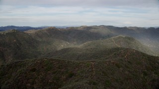 AX0157_016 - 8K stock footage aerial video of rolling green Santa Monica Mountains, California