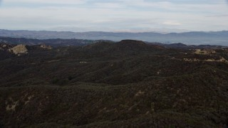 AX0157_019 - 8K stock footage aerial video flying over green Santa Monica Mountains in California