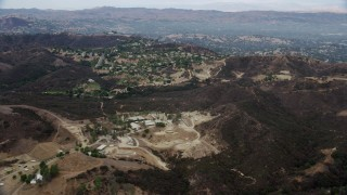 AX0157_020 - 8K stock footage aerial video of homes on a hill in Topanga, California