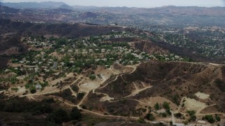 AX0157_021 - 8K stock footage aerial video of a small neighborhood in the hills of Topanga, California