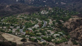 AX0157_022 - 8K stock footage aerial video flying by homes on a hill in Topanga, California