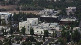 AX0157_031 - 8K stock footage aerial video approaching West Hills Hospital in West Hills, California