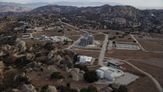 AX0157_049 - 8K stock footage aerial video orbiting buildings at the Rocketdyne aerospace testing facility in Brandeis, California